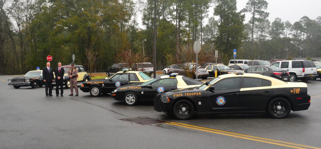 David Neil Kirkman next to trooper cars