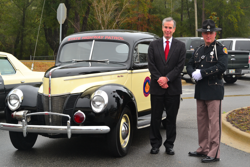 David Neil Kirkman next to old trooper car